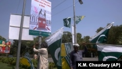 Pakistani and Kashmiri flags are displayed around Lahore, Pakistan, ahead of nationwide anti-India protests.
