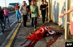 A civilian reportedly killed by Turkish soldiers lies on the ground on the Bosphorus bridge in Istanbul.