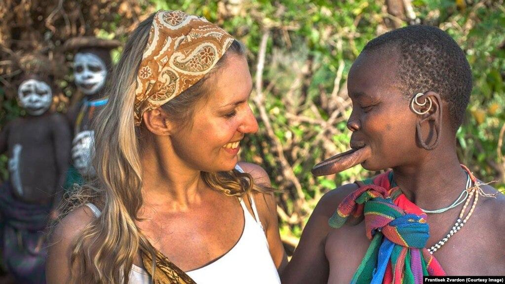 Ethiopia--Czech journalist Lenka Klicperova with a woman from the Suma  tribe.