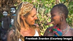 Ethiopia--Czech journalist Lenka Klicperova with a woman from the Suma tribe.