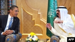 Saudi Arabia's King Abdullah (right) speaks with U.S. President Barack Obama in Riyadh on June 3.