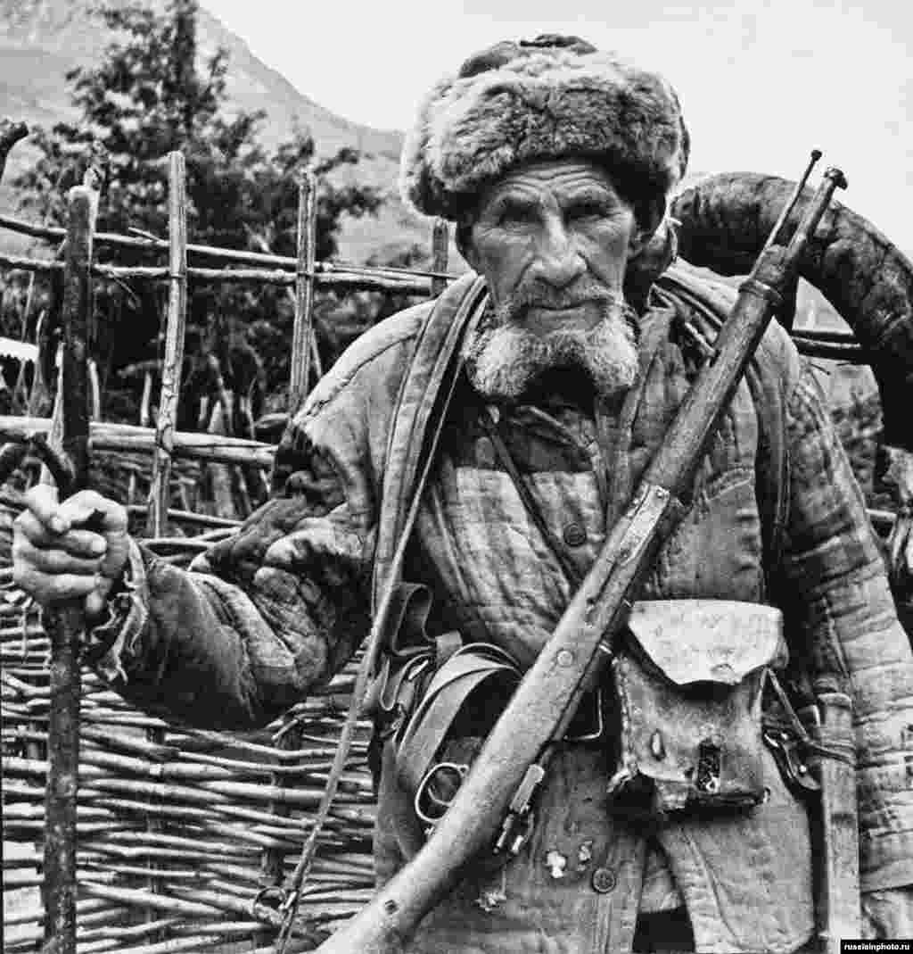 "A Ossetian hunter photographed in the 1970s. Ossetians are an Iranian ethnic group who speak a language related to Persian.   In 1989, the South Ossetian population of around 98,500 was two-thirds ethnic Ossetian and about one-third ethnic Georgian. An observer noted both Georgians and Ossetians ""are among the Soviet Union's most sociable people. They like to drag strangers by the arm to the hospitality of good food and impassioned toasts about freedom."""