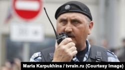 Sergei Kusyuk is seen now serving in Russian special police forces in Moscow in June 2017.
