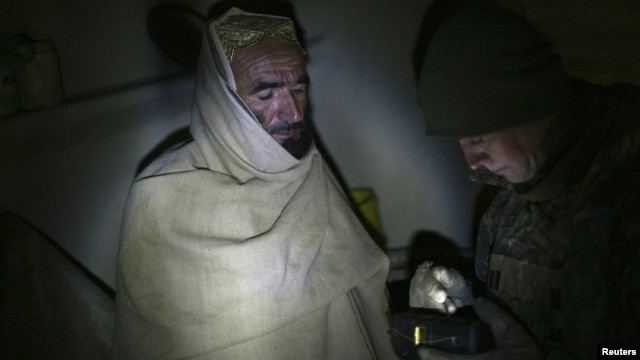Night raids involving American troops are one of the biggest bones of contention in a draft Afghan-U.S. security agreement. (file photo)