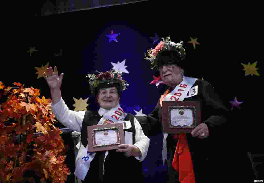 "Lida Maisuradze (left), 83, and Tristan Kvatashidze, 86, celebrate after winning the ""Super Grandmother and Super Grandfather"" contest in Tbilisi, Georgia. Twenty-four participants aged 70 and over from all over Georgia competed in the annual contest, organized by charity house Catharsis. (Reuters/David Mdzinarishvili)"