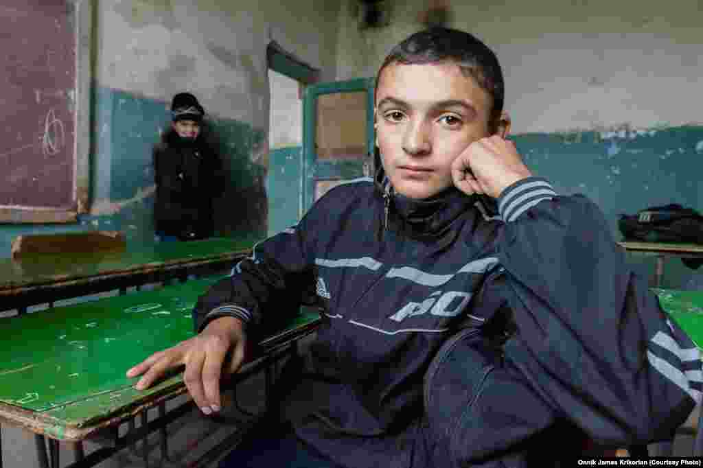 An ethnic Armenian pupil in a dilapidated classroom. Students and teachers are waiting for the Georgian government to fulfill its promises to help repair the school.