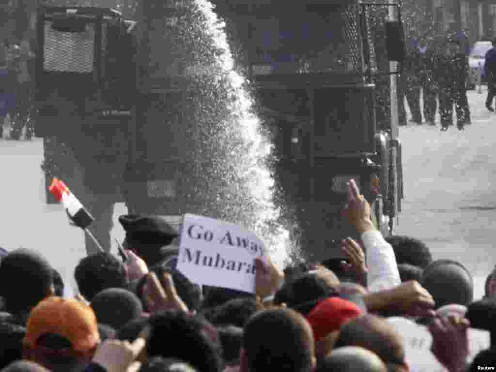 Police use a water cannon against antigovernment protesters in downtown Cairo on January 25, 2011.