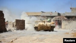 IRAQ -- A tank of Iraqi army fires against Islamic State militants at Al Jazeera neighbourhood of Tal Afar, August 23, 2017