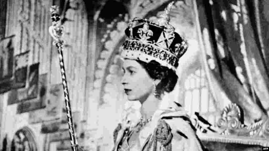 Queen Elizabeth II poses on her coronation day, June 2, 1953, nearly 1 1/2 years after she became queen regnant upon the death of her father, George VI, on February 6, 1952. Hers was the first coronation to be televised.