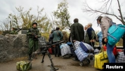 "The report says separatist groups controlling parts of the Donetsk and Luhansk regions ""continue to deprive people of their basic rights and of any effective mechanism for redress."""