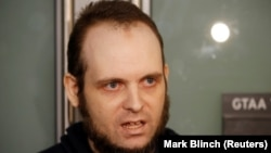 FILE: Joshua Boyle speaks to the media in Toronto in October.