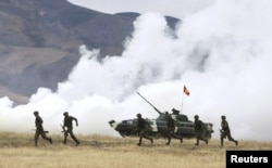 Kyrgyzstan -- Servicemen take part in the Collective Security Treaty Organisation (CSTO) military exercises outside Bishkek, 21Sep2011