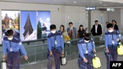 Health officials disinfect the passenger terminal at Incheon International Airport in Seoul.