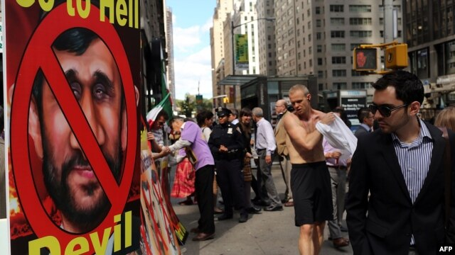 Demonstrators participate in a rally against Ahmadinejad near the Warwick New York Hotel on September 24.