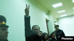 Armenia - Opposition leader Nikol Pashinian greets supporters as he is sentenced to seven years in prison on controversial charges,19Jan,2010