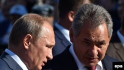 Russian President Vladimir Putin (left) and Defense Minister Sergei Shoigu