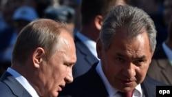 Russian President Vladimir Putin (left) and Defense Minister Sergei Shoigu