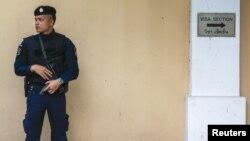 Сотрудник сил безопасности Таиланда.