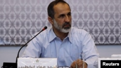 Президент Национальной коалиции Сирии Моаз аль-Хатиб.
