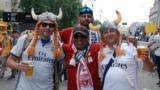 Supporters of Liverpool FC and Real Madrid mingle in a special fan zone in Kyiv, which tonight is hosting the final of the Champions League, European club soccer's premier competition.