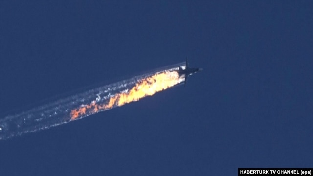 A still image from video footage shows a burning trail as the Russian jet crashes after being shot down near the Turkish-Syrian border.