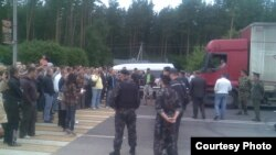 Protesters rally at the Belarusian-Polish border crossing near Hrodna on June 12.
