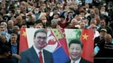 Government supporters hold a banner of Serbian President Aleksandar Vucic (left) and Chinese President Xi Jinping at a demonstration outside parliament in Belgrade in May 2020.