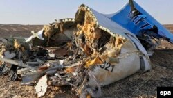 Debris from the Russian airliner that crashed on Egypt's Sinai Peninsula lies strewn across a wide area.