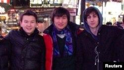 Boston Marathon bombing suspect Dzhokhar Tsarnaev (right) poses with Azamat Tazhayakov (left) and Dias Kadyrbaev in an undated photo taken in New York City.