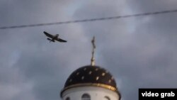 A grab from a YouTube video purporting to show Swede Tomas Mazetti in an airplane over Belarus dropping pro-free speech teddy bears on July 4.