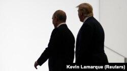 Владимир Путин и Дональд Трамп на встрече в Осаке, 28 июня 2019 года