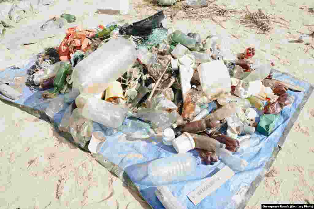 A pile of garbage collected by a Greenpeace expedition in mid-August. On their first day, they collected 78 kilograms of waste along a stretch of shoreline on Lake Ladoga, most of it disposable plastic.