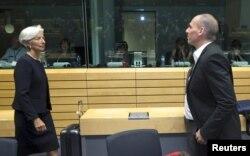 Виконавчий директор МВФ Крістін Лагард (ліворуч) та міністр фінансів Греції Яніс Варуфакіс. Брюссель, 25 червня 2015 року