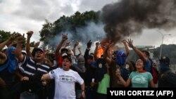 Протесты против Мадуро в Каракасе. 23 января 2019 года