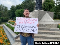 "An activist holds a placard reading ""Internet Freedom--Freedom in Kazakhstan' against what she called the government's attempt to restrict the freedom of Internet users, in Nur-Sultan in July."