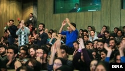 Audience members chanting at a Student Day event at Tehran University on December 7.