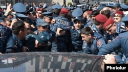 Armenia -- Riot police clash in Yerevan with employees of the Spayka company protesting against the arrest of its chief executive, Davit Ghazarian, April 4, 2019.