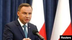 Polish President Andrzej Duda has yet to sign the controversial judicial reforms into law. (file photo)