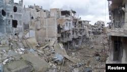 Хомс шаарынын Журет аш-Шая районундагы кыйраган турак-үйлөр. 29-январь 2013