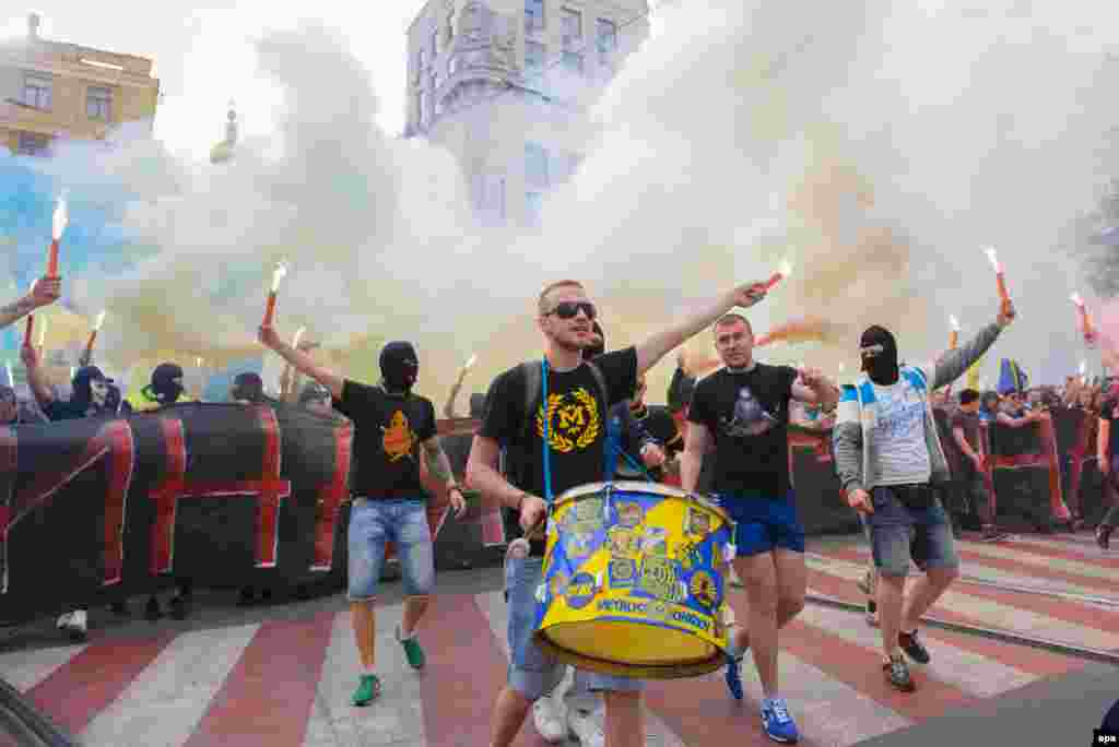 Fans of the Ukrainian soccer clubs Metalist and Dnipro,who are normally implacable enemies, gather during a march to support a united Ukraine in Kharkiv on April 27. (epa/Olga Ivashchenko)