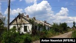 Руїни в селі Опитному після обстрілів бойовиків, архівне фото