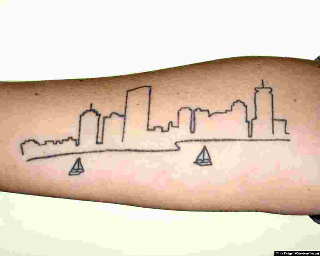 The tattoo on Kate's arm is based on a photograph she took of the Charles River, where she enjoys kayaking.