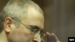 Russia -- Mikhail Khodorkovsky reacts after reading of the verdict during a court session in Moscow, 30Dec2010