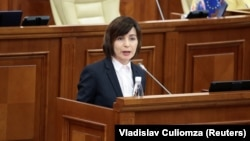 Moldovan Prime Minister Maia Sandu delivers a speech to parliament in Chisinau on November 12.