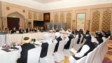 QATAR -- Taliban and Qatar officials attend a meeting for peace talks in Doha, March 12, 2019