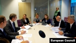 The EU's Federica Mogherini (center) meets with Kosovar Prime Minister Isa Mustafa (second from right) and Serbian Prime Minister Aleksandar Vucic (second from left) in Brussels on August 25.