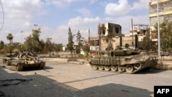 Колонна армии Асада входит в Алеппо