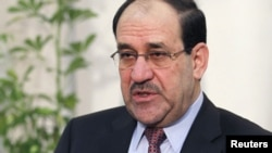 Iraqi officials say Prime Minister Nuri al-Maliki may have been the intended target of a suicide car bombing earlier this week in Baghdad.