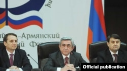 Armenia -- President Serzh Sarkisian (C), Russian presidential administration chief Sergei Naryshkin (L) and Russian Transport Minister Igor Levitin open a Russian-Armenian interregional conference in Yerevan, 19Apr2011.
