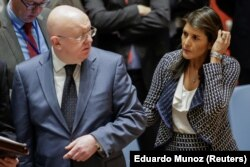 Haley and Russia's UN Ambassador Vasily Nebenzya before a UN Security Council meeting on Syria in April